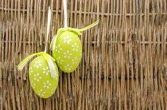 Two easter eggs. Decorated Easter Eggs  surrounded by bambu background Stock Images