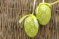 Two easter eggs. Decorated Easter Eggs  surrounded by bambu background Stock Image