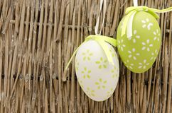 Two easter eggs. Decorated Easter Eggs  surrounded by bambu background Royalty Free Stock Photos
