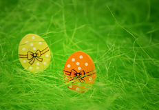Two easter eggs. On green background. Decoration royalty free stock image