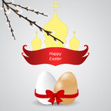 Two Easter eggs with banner, willow branches and church domes. Stock Photo