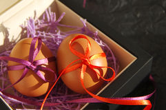 Two Easter eggs are decorated bright with color tapes Stock Photos