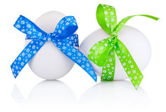 Two Easter eggs with festive bow isolated on white background Royalty Free Stock Photo