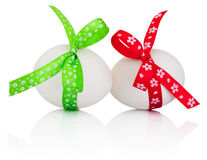 Two Easter eggs with festive bow isolated on white background Royalty Free Stock Photos