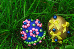 Two Easter eggs in green grass Royalty Free Stock Image