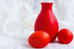 Two Easter Eggs And A Jug On A Lace Stock Image