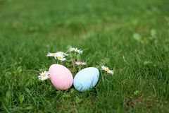 Two easter eggs, ping and blue, in a grass royalty free stock photos