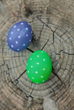 Two Easter eggs on a stump Stock Images