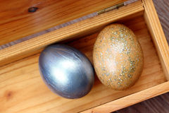 Two easter eggs in wood box Stock Photos