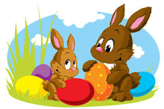 Two easter rabbits with eggs Royalty Free Stock Photos