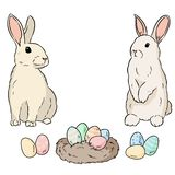 Two easter rabbits and easter eggs. Cartoon image colorful doodle. Lineart sketch stock illustration