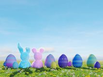 Two easter rabbits sitting in lawn with easter eggs. 3d rendering. 3d rendering. two easter rabbits sitting in lawn with easter eggs Royalty Free Stock Images