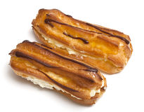 Two eclairs on a white background Royalty Free Stock Image