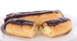 Two Eclairs on White Plate Stock Images