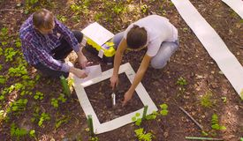 Free Two Ecologist Getting Samples Of Soil In The Forest Royalty Free Stock Images - 128871719