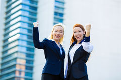 Two ecstatic business woman celebrating success Royalty Free Stock Photos