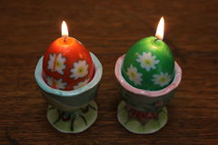 Two egg shaped candles Royalty Free Stock Images