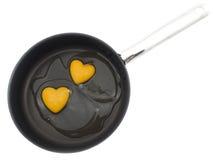 Two egg yolk heart-shape Royalty Free Stock Image