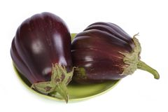 Two eggplant on green plate isolated on white Royalty Free Stock Photography