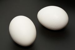 Two eggs. On black background Royalty Free Stock Photography