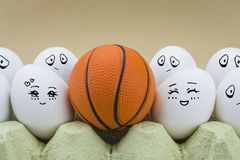 Two eggs is affectionately regarded a basketball ball. Isolated on brown background Royalty Free Stock Images