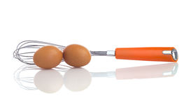 Two eggs with a balloon whisk Royalty Free Stock Photos