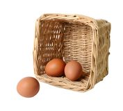 Two eggs in a basket and one separately Stock Photo