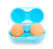 Two eggs in the blue box. Two brown eggs in the blue box isolated on a white background Royalty Free Stock Photos