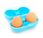 Two eggs in the blue box. Two brown eggs in the blue box isolated on a white background Stock Photos