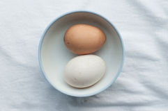 Two eggs in cup on fabric background Stock Photography