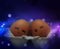 Two eggs feel love. Two lover eggs are ready to sleep at night Stock Images