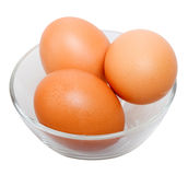 Brown eggs in glass bowl. Isolated on the white background Royalty Free Stock Photography