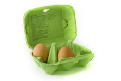 Two eggs in a green egg carton. Over white Stock Photography