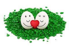 Two eggs on green stones. Royalty Free Stock Photography