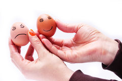 Two eggs in hands Royalty Free Stock Photo