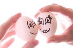 Two eggs in hands isolated Royalty Free Stock Image