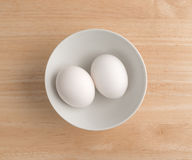 Free Two Eggs In A Bowl Atop A Wood Table Top. Royalty Free Stock Photo - 83772975