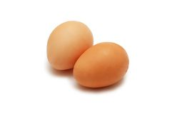 Two eggs isolated on the white Royalty Free Stock Photos