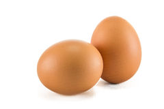 Two eggs are isolated on a white background. Stock Photography