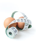 Two Eggs with Measuring Tape Stock Photo