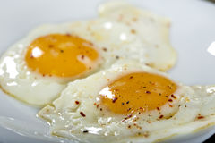 Two eggs with pepper and dried hot chilli Royalty Free Stock Photo