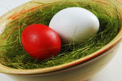 Two eggs  in a plate with green grass Stock Photo