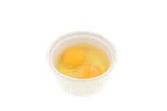 Two eggs in a ramekin Stock Photos