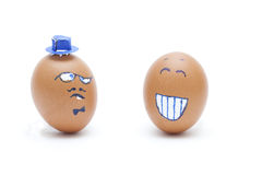 Two eggs smiley and serious face Royalty Free Stock Photos