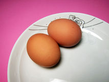 Two eggs in a white plate Royalty Free Stock Image