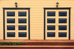 A pair of elegant eight panel doors side by side royalty free stock photography