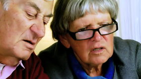 Two elder people discussing serious closeup stock video footage