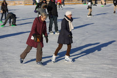 Two elder women ice skating Royalty Free Stock Photo
