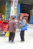 Two elderly Chinese women meet in Xingping,China Stock Image
