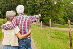 Two elderly farmers on a farm Royalty Free Stock Image